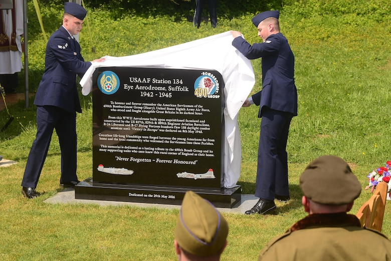 Airmen from the 100th Air Refueling Wing unveil the 490th Bombardment Group Memorial, May 29, in the village of Brome, England. Over 100 attendees gathered to witness the permanent monument dedicated to the men of the 490th for their contributions during World War II. (U.S. Air Force photo/ Tech Sgt. Matthew Plew)