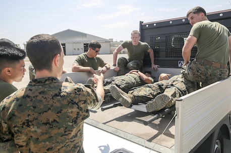 Lt. Cmdr. Robert Oldt, an emergency physician with Special Purpose Marine Air-Ground Task Force Crisis Response-Africa, gives instruction about the appropriate casualty procedures to the Marines responsible for loading and unloading the simulated casualties on the flightline at Naval Air Station Sigonella, Italy, May 24, 2016. The Naval Forward Resuscitative Surgical System-Shock Trauma Platoon partnered with Marines during the drill to ensure readiness in the event of receiving a casualty. (U.S. Marine Corps photo by 1st Lt. Eric Abrams/released)