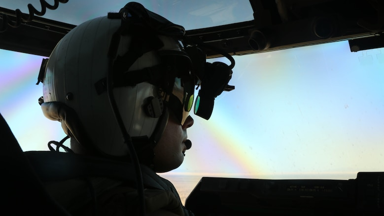 """A Marine with Marine Medium Tiltrotor Squadron (VMM) 364 """"Purple Foxes"""" flies an MV-22B Osprey during section and division confined area landings at Holtville Airfield, Calif., May 20. The training was conducted to familiarize both pilots and crew chiefs with landing in a small area around other aircraft."""