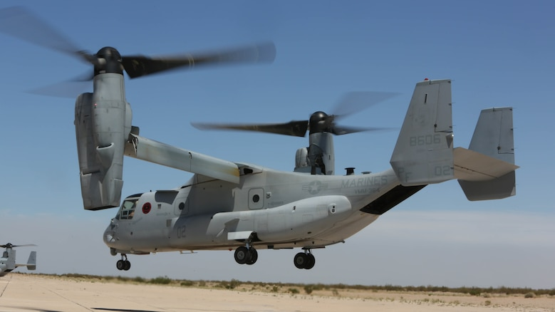 """An MV-22B Osprey with Marine Medium Tiltrotor Squadron (VMM) 364 """"Purple Foxes"""" lands during section and division confined area landings at Holtville Airfield, Calif., May 20. The training was conducted to familiarize both pilots and crew chiefs with landing in a small area around other aircraft. ("""