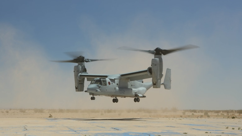 """An MV-22B Osprey with Marine Medium Tiltrotor Squadron (VMM) 364 """"Purple Foxes"""" lands during section and division confined area landings at Holtville Airfield, Calif., May 20. The training was conducted to familiarize both pilots and crew chiefs with landing in a small area around other aircraft."""