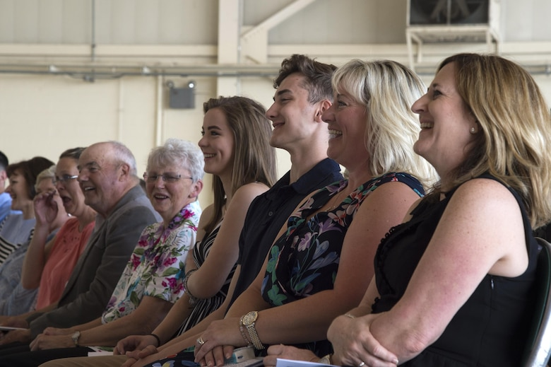 Family and friends of U.S. Air Force Chief Master Sgt. David Kelch, 23d Wing command chief, share a laugh during his retirement ceremony at Moody Air Force Base, Ga., May 26, 2016. The ceremony included remarks from Brig. Gen Chad Franks, senior executive officer to the Air Force vice chief of staff, a tribute by Moody's First Sergeant Association and a flag presentation. (U.S. Air Force photo by Airman 1st Class Janiqua P. Robinson/Released)