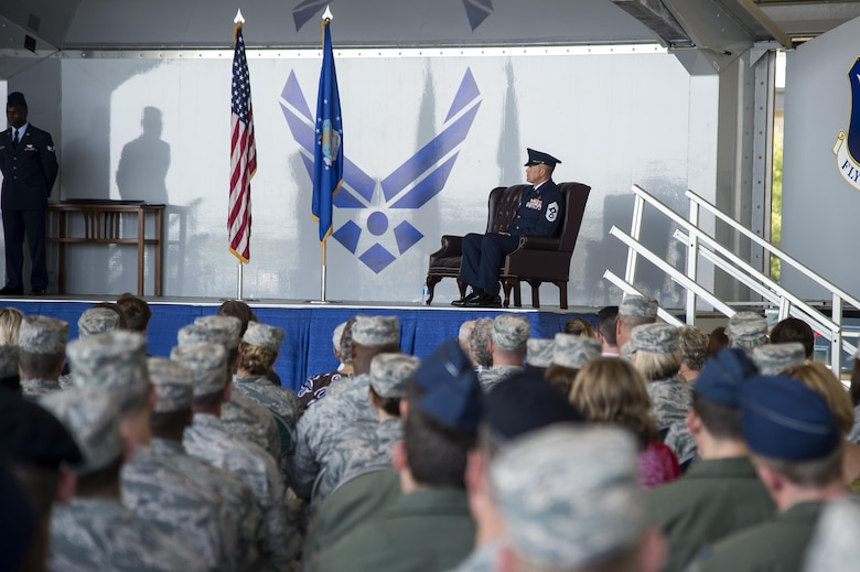 U.S. Air Force Chief Master Sgt. David Kelch, 23d Wing command chief, listens as Brig. Gen. Chad Franks, senior executive officer to the Air Force vice chief of staff, gives his remarks during a retirement ceremony at Moody Air Force Base, Ga., May 26, 2016. Franks thanked Kelch for all his hard work and dedication during their time working together at the 23d WG.. (U.S. Air Force photo by Airman 1st Class Janiqua P. Robinson/Released)