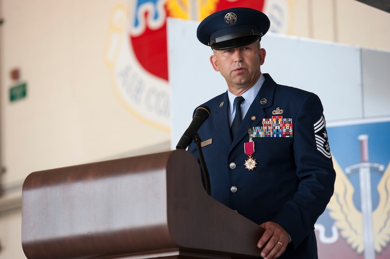 U.S. Air Force Chief Master Sgt. David Kelch, 23d Wing command chief, addresses the crowd during his retirement ceremony at Moody Air Force Base, Ga., May 26, 2016. Kelch, a Montana native, is retiring after 29 years and seven months of military service. (U.S. Air Force photo by Andrea Jenkins/Released)