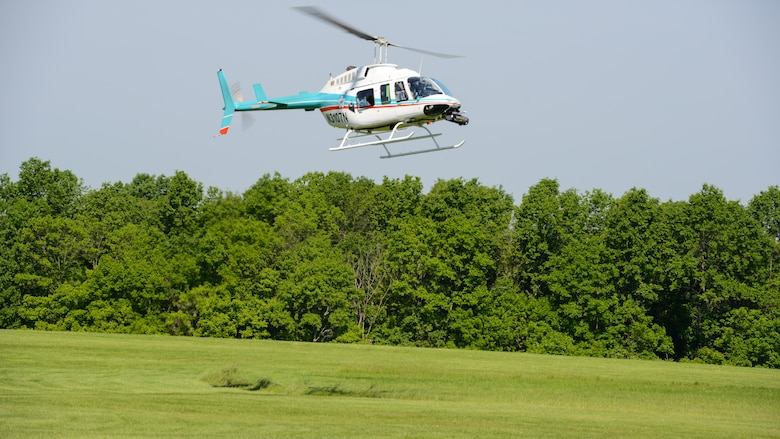 Aurora flight sciences tests the Autonomous Aerial Cargo/Utility System on a Bell 206 helicopter in Bealeton, Virginia, May 25, 2016. The AACUS system is designed to quickly detach and attach to various different aircraft the Marine Corps uses to help with mission accomplishment.