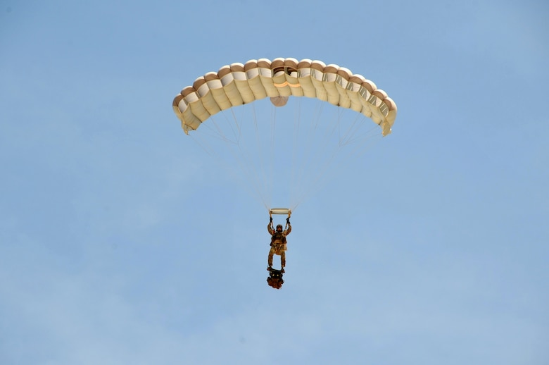 A pararescueman assigned to the 306th Rescue Squadron descends on Eloy, Ariz., during training May 14. Air Force pararescuemen, also known as PJs, are the only Department of Defense elite combat forces specifically organized, trained, equipped and postured to conduct full-spectrum personnel recovery to include both conventional and unconventional combat rescue operations. These battlefield Airmen are the most highly trained and versatile personnel recovery specialists in the world. Pararescue is the nation's force of choice to execute the most perilous, demanding and extreme rescue missions anytime, anywhere across the globe.  (U.S. Air Force photo by Tech. Sgt. Carolyn Herrick)