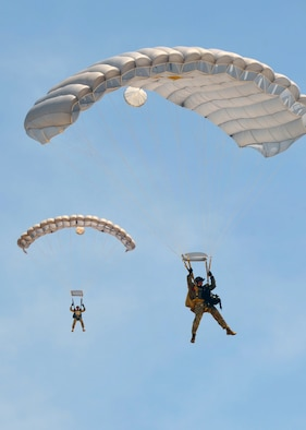 Pararescuemen from the 306th Rescue Squadron at Davis-Monthan Air Force Base, Ariz., descend on Eloy, Ariz., during training jumps May 14. The 306th RQSis an Air Force Reserve Command combat search and rescue unit assigned to the 943rd Rescue Group. Pararescuemen, also known as PJs, are the only Department of Defense elite combat forces specifically organized, trained, equipped and postured to conduct full-spectrum personnel recovery to include both conventional and unconventional combat rescue operations. These battlefield Airmen are the most highly trained and versatile personnel recovery specialists in the world. (U.S. Air Force photo by Tech. Sgt. Carolyn Herrick)