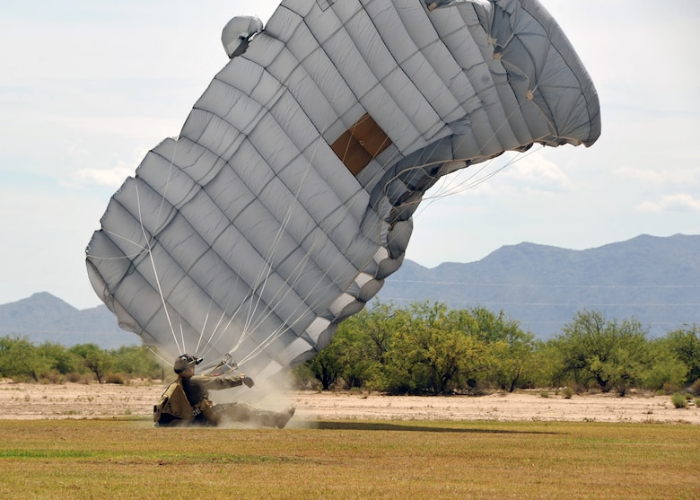 A U.S. Air Force Reserve pararescueman from the 306th Rescue Squadron lands in a skydiving field in Eloy, Ariz., during training May 14. Pararescuemen, also known as PJs, are the only Department of Defense elite combat forces specifically organized, trained, equipped and postured to conduct full-spectrum personnel recovery to include both conventional and unconventional combat rescue operations. These battlefield Airmen are the most highly trained and versatile personnel recovery specialists in the world. (U.S. Air Force photo by Tech. Sgt. Carolyn Herrick)