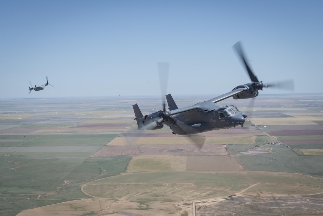 CV-22 Ospreys with the 20th Special Operations Squadron trail behind an MC-130J Commando II during the Air Commando Capabilities Demonstration at the Air Commandos on the High Plains air show May 28, 2016 at Cannon Air Force Base, N.M.  The 2016 Cannon Air Show highlights the unique capabilities and qualities of Cannon's Air Commandos and also celebrates the long-standing relationship between the 27th Special Operations Wing and the High Plains community. (U.S. Air Force photo/Senior Airman Shelby Kay-Fantozzi)