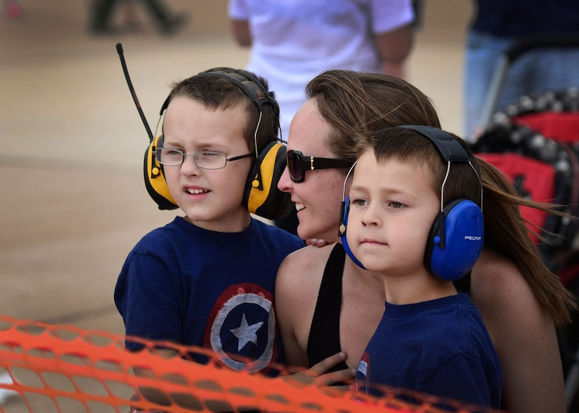 Children prepare to watch the Thunderbird performance during the Cannon Air Show May 29, 2016, at Cannon Air Force Base, N.M. The 2016 Cannon Air Show highlights the unique capabilities and qualities of Cannon's Air commandos and also celebrates the long-standing relationship between the 27th Special Operations Wing and the High Plains community. (U.S. Air Force photo/Senior Airman Chip Slack)