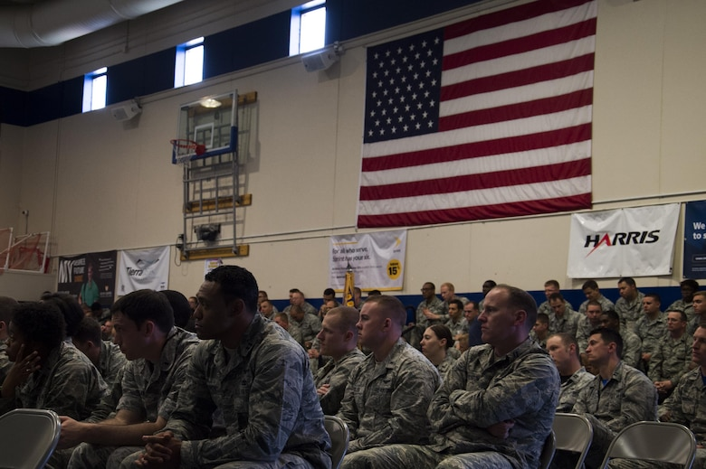 Airmen with the 50th Operations Group attend a Space Mission Force transition event, which coincided with a commander's call at Schriever Air Force Base, Colorado, May 26, 2016. The event is a new iteration of what the group has done in the past, which previously included a commander's call, crud tournament and socialization. This time, the event added a more informational tone for Airmen entering their combat rotation through the SMF construct. (U.S. Air Force photo/Tech. Sgt. Julius Delos Reyes)