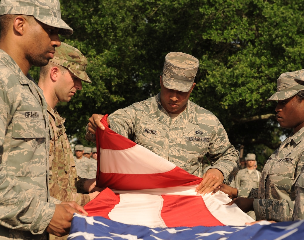 Members of the 334th Training Squadron fold the U.S. flag during the 81st Training Wing Memorial Day Retreat Ceremony May 26, 2016, Keesler Air Force Base, Miss. The ceremony was held in memory of Operation Desert Storm. (U.S. Air Force photo by Kemberly Groue)