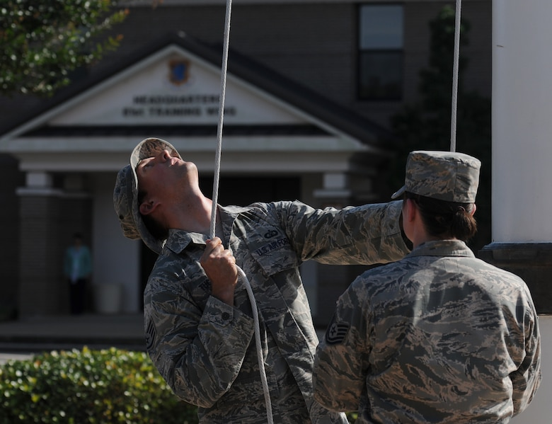 Staff Sgt. Jacob Tucker, 334th Training Squadron instructor, lowers the U.S. flag during the 81st Training Wing Memorial Day Retreat Ceremony May 26, 2016, Keesler Air Force Base, Miss. The ceremony was held in memory of Operation Desert Storm. Attendees were also encouraged to wear uniforms from their past deployments. (U.S. Air Force photo by Kemberly Groue)
