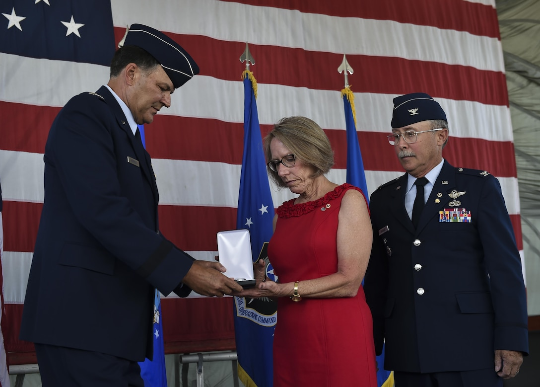 The family of Capt. Matthew D. Roland, a Special Tactics officer killed in action, was presented his posthumous Silver Star medal by Lt. Gen. Brad Heithold, commander of Air Force Special Operations Command, Hurlburt Field, Fla., June 1, 2016. Roland gave his last full measure to protect teammates during an ambush on his convoy at an Afghan-led security checkpoint near Camp Antonik, Afghanistan, Aug. 26, 2015. The Silver Star medal is the nation's third-highest valorous combat decoration.  (U.S. Air Force photo by Senior Airman Ryan Conroy/Released)