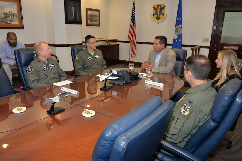 Dred Madison, 12th Flying Training Wing terminal instrument procedures chief, Lt. Col. Emil Bliss, 12th FTW community innitiatives chief, and Col. Michael Snell, 12th FTW commander, meet with Rep. John Lujan, Texas House of Representatives member, in the Wing Conference Room at bldg. 100 at Joint Base San Antonio-Randolph during an orientation tour, May 31, 2016. Lujan learned about compatible development, bird air strike hazards, and visited the air traffic control tower and flight simulator facility among. (U.S. Air Force photo by Randy Martin/Realsed)