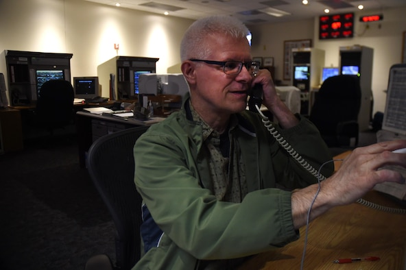 Kevin Cox, Air Force Satellite Control Network satellite network scheduler, unschedules a satellite support at Schriever Air Force Base, Colorado, Tuesday, May 31, 2016. Cox is currently in his 16th year as a 22nd Space Operations Squadron civilian scheduler but served as an enlisted member at Schriever back in 1990. (U.S. Air Force photo/2nd Lt. Darren Domingo)