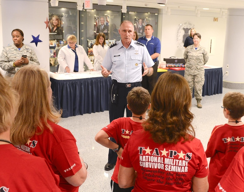 Lt. Gen. William J. Bender, the Air Force's information dominance chief and chief information officer, welcomes survivors of fallen service members during a tour of the Pentagon in Washington, D.C., May 27, 2016. Defense Secretary Ash Carter and his wife Stephanie hosted more than 300 family members during family night in the Pentagon. (U.S. Air Force photo/Andy Morataya)