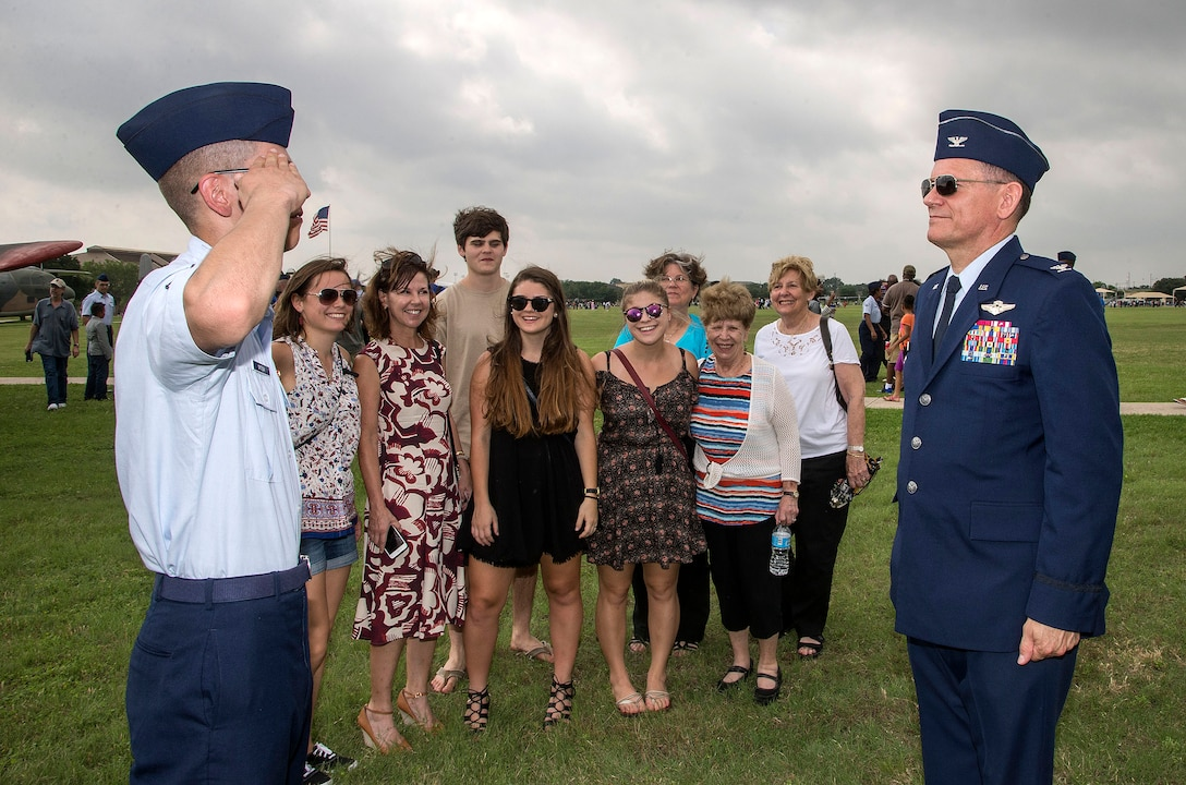 Retiring Col. Hernando J. Ortega, Jr., Air Education and Training Command Aerospace Medicine Division chief, and his son, Airman 1st Class Hernando J. Ortega III, shared a first salute as each offered congratulations to the other after Air Force Basic Military Training graduation parade May 27, 2016, at Joint Base San Antonio-Lackland, Texas. Retiring Col. Ortega, Jr. watched his son, Airman 1st Class Hernando J. Ortega III, graduate from Air Force Basic Military Training at JBSA-Lackland, then headed downtown for his retirement ceremony at the Alamo that same afternoon. (U.S. Air Force photo by Johnny Saldivar)