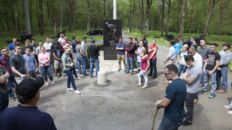 """Marines from Headquarters and Service Battalion, Headquarters Marine Corps, Henderson Hall and Marine Barracks Washington, D.C., pause to reflect at the Marine Monument in the woods of Belleau, France May 26, 2016. The commanding general of the French 6th Army officially renamed Belleau Wood as """"Wood of the Marine Brigade"""", June 30, 1918."""