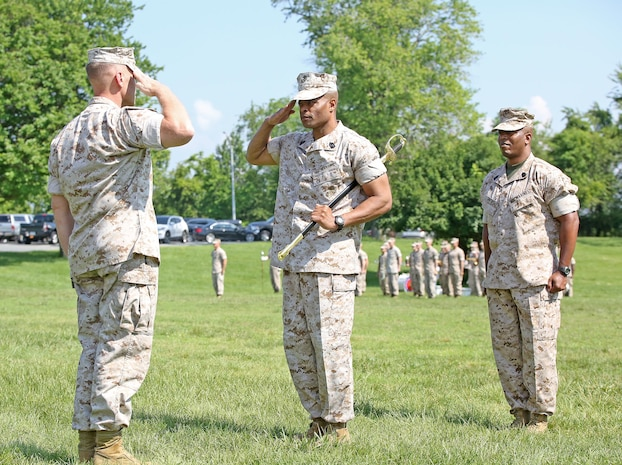 Sgt. Maj. Fletcher Pearson (center) prepares to pass the noncommissioned officer sword to Brig. Gen. Joseph Shrader (left), commander of Marine Corps Systems Command, during a Relief and Appointment ceremony June 1 aboard Marine Corps Base Quantico, Virginia. Pearson, who retired after 30 years in the Marine Corps, relinquished responsibility as the command's senior enlisted leader to Sgt. Maj. Gary Smith (right). (U.S. Marine Corps photo by Monique Randolph)