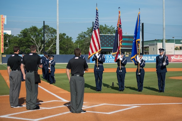 Members of the Keesler Honor Guard perform military honors at MGM Park during the Biloxi Shuckers Minor League Baseball Military Appreciation Game May 29, 2016, Biloxi, Miss. Keesler children and leadership also attended the event honoring local military members. (U.S. Air Force photo by Marie Floyd)