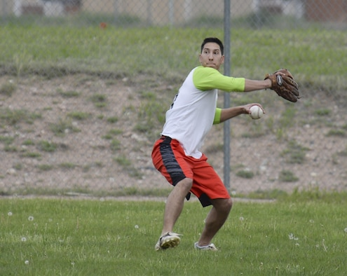 Chris Pilla, 90th Munitions Squadron intramural softball team player, throws the ball from the outfield during a play against the 790th Missile Security Forces Squadron team May 31, 2016, on one of the F.E. Warren Air Force Base, Wyo., ball fields. The MUNS team went on to win, making their record 3 and 0 for the season. (U.S. Air Force photo by Senior Airman Jason Wiese)