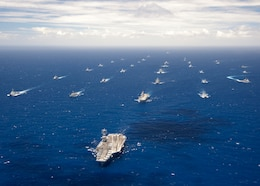 In this file photo, Ships and submarines participating in Rim of the Pacific (RIMPAC) exercise 2012 sail in formation in the waters around the Hawaiian Islands July 27, 2012. RIMPAC is a U.S. Pacific Command-hosted biennial multinational maritime exercise designed to foster and sustain international cooperation on the security on the world?s oceans.