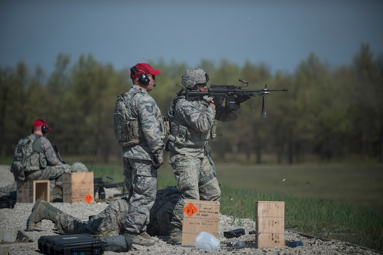 An Airman assigned to the 107th Security Forces Squadron, Niagara Falls Air Reserve Station, N.Y., engages targets with a M249 machine gun during heavy weapons training at Camp Grayling, MI., May 21, 2016. The training is part of an annual requirement for security forces in order to remain proficient and qualified on the weapon systems they are expected to carry. (U.S. Air Force photo by Staff Sgt. Ryan Campbell/released)