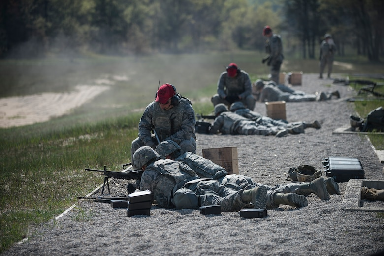 Airmen assigned to the 107th Security Forces Squadron, Niagara Falls Air Reserve Station, N.Y., engage targets with M249 machine guns during heavy weapons training at Camp Grayling, MI., May 21, 2016. The training is part of an annual requirement for security forces in order to remain proficient and qualified on the weapon systems they are expected to carry. (U.S. Air Force photo by Staff Sgt. Ryan Campbell/released)