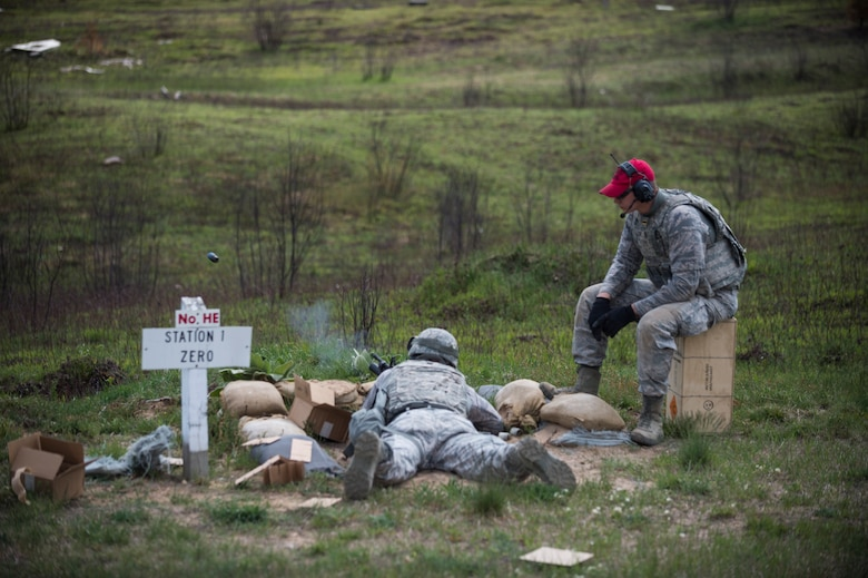 An Airman assigned to the 107th Security Forces Squadron, Niagara Falls Air Reserve Station, N.Y., engages targets with a M203 grenade launcher during heavy weapons training at Camp Grayling, MI., May 21, 2016. The training is part of an annual requirement for security forces in order to remain proficient and qualified on the weapon systems they are expected to carry. (U.S. Air Force photo by Staff Sgt. Ryan Campbell/released)