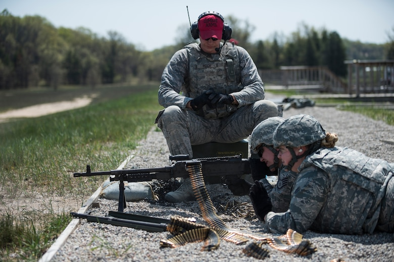 An Airman assigned to the 107th Security Forces Squadron, Niagara Falls Air Reserve Station, N.Y., engages targets with a M240B machine gun during heavy weapons training at Camp Grayling, MI., May 21, 2016. The training is part of an annual requirement for security forces in order to remain proficient and qualified on the weapon systems they are expected to carry. (U.S. Air Force photo by Staff Sgt. Ryan Campbell/released)