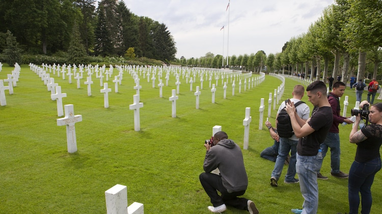 Marines from Headquarters and Service Battalion, Headquarters Marine Corps, Henderson Hall and Marine Barracks Washington, D.C., take photos of the grave marker for Lt. j.g. Weedon Osborne the only Medal of Honor recipient interred at Aisne-Marne American Cemetery in Belleau, France, May 26, 2016. Osborne was a dentist who served as corpsman for the 6th Marine Regiment and was killed in action trying to carry an injured Marine to safety June 6, 1918.