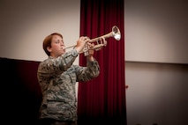 """U.S. Air Force Airman Alyssa Flanagan, 39th Security Forces Squadron security response team member, plays """"Taps"""" during a Memorial Day remembrance ceremony at the base chapel May 27, 2016, at Incirlik Air Base, Turkey. """"Taps"""", traditionally played at military funerals, is a song meant to honor the sacrifice of fallen servicemembers. (U.S. Air Force photo by Staff Sgt. Jack Sanders/Released)"""