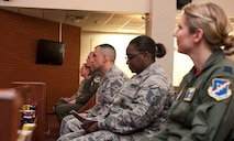 Airmen listen to U.S. Air Force Chaplain (Capt.) David Merrifield, 39th Air Base Wing, speak during a Memorial Day remembrance ceremony at the base chapel May 27, 2016, at Incirlik Air Base, Turkey. Merrifield spoke on remembering we stand on the shoulders of those who came before us and paid the ultimate price. (U.S. Air Force photo by Staff Sgt. Jack Sanders/Released)