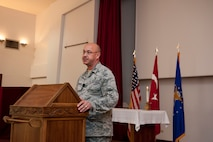 U.S. Air Force Chaplain (Capt.) David Merrifield, 39th Air Base Wing, speaks to the audience at a Memorial Day remembrance ceremony held at the base chapel May 27, 2016, at Incirlik Air Base, Turkey. Merrifield spoke on remembering we stand on the shoulders of those who came before us and paid the ultimate price. (U.S. Air Force photo by Staff Sgt. Jack Sanders/Released)