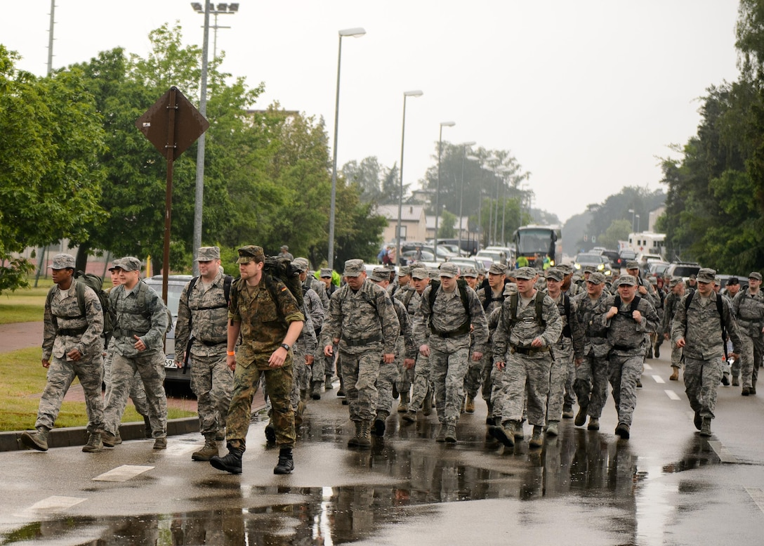 Members of the Kaiserslautern Military Community march during the first Chief Master Sgt. Paul Airey Memorial ruck-run at Ramstein Air Base, Germany, May 27, 2016. The ruck-run was completed by more than 300 participants in remembrance of the march Airey completed as a prisoner of war. (U.S. Air Force photo/Staff Sgt. Armando A. Schwier-Morales)