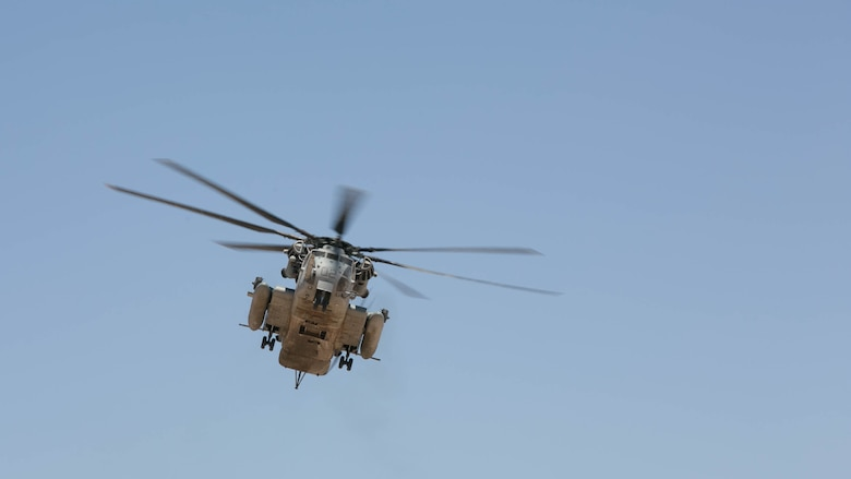 A CH-53 'Super Stallion' flies near the Combat Ville training area aboard Marine Corps Air Station Yuma, Ariz., during Integrated Training Exercise 3-16, May 29, 2016.