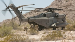 Scout snipers with 2nd Battalion, 8th Marine Regiment, board a CH-53 'Super Stallion' for extraction from the Combat Ville training area aboard Marine Corps Air Station Yuma, Ariz., during Integrated Training Exercise 3-16, May 29, 2016.