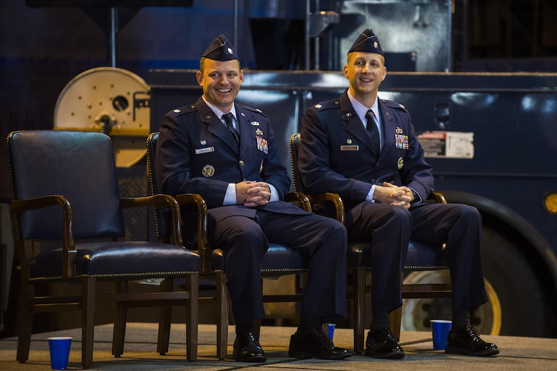 U.S. Air Force Lt. Col. Christopher Meeker, former 52nd Civil Engineer Squadron commander, left, and U.S. Air Force Lt. Col. Ryan Crowley, 52nd CES commander, smile during the 52nd CES change of command at Spangdahlem Air Base, Germany, June 1, 2016. Crowley assumed command of the 52nd CES from Meeker. (U.S. Air Force photo by Senior Airman Luke Kitterman/Released)