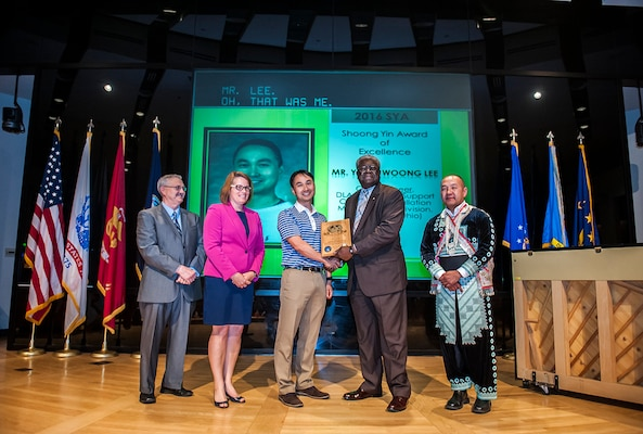 Yong Woong Lee (middle), a civil engineer with DLA Installation Support-Columbus, received the 2016 Shoong Yin Award for his dedication and commitment to the AAPI community. Pictured (l-r) is: Paul Gambrell, DLA Land and Maritime Equal Employment Office; Rebecca Beck, DFAS-Columbus deputy director; Lee; Milton Lewis, DLA Land and Maritime acquisition executive; and Yee Hang, Land Supplier director.