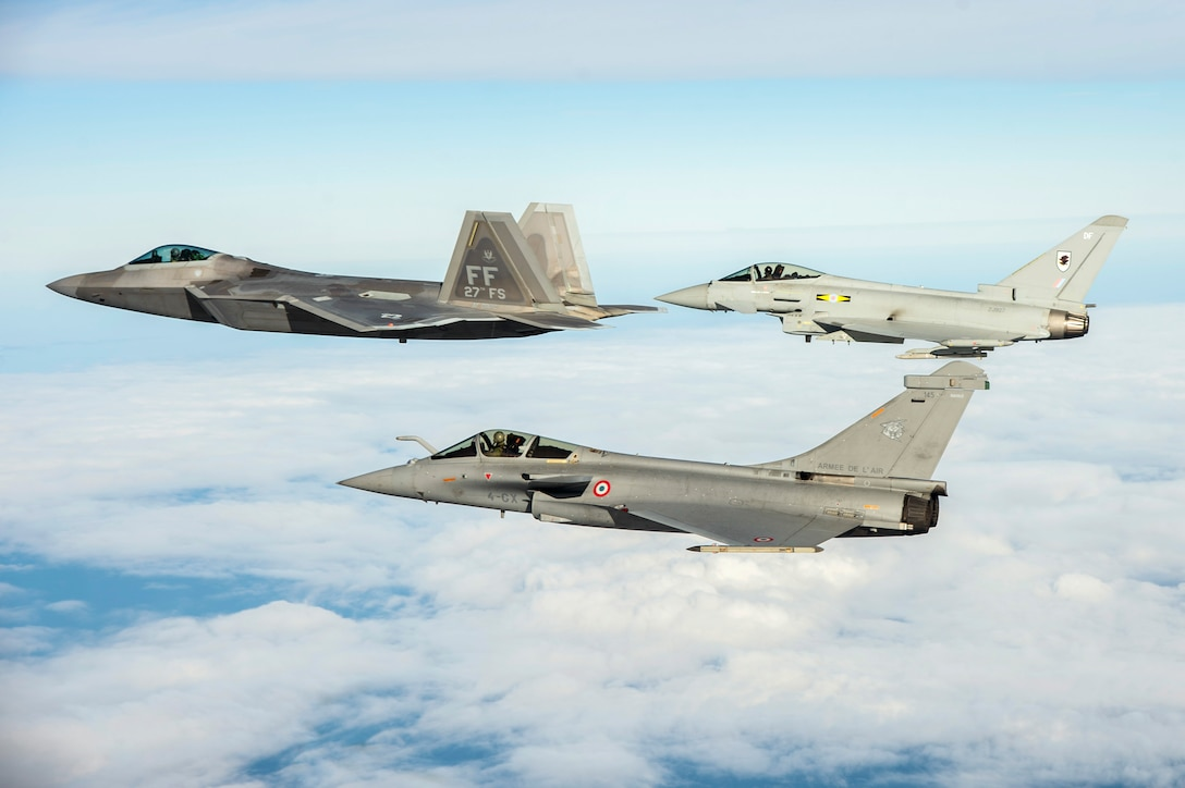 12/9/2015 - A U.S. Air Force F-22 Raptor, British Royal Air Force Typhoon, and French air force Rafale fly in formation as part of a Trilateral Exercise held at Langley Air Force Base, Va., Dec. 7, 2015. The exercise simulates a highly-contested, degraded and operationally-limited environment where U.S. and partner pilots and ground crews can test their readiness. (U.S. Air Force photo by Senior Airman Kayla Newman)