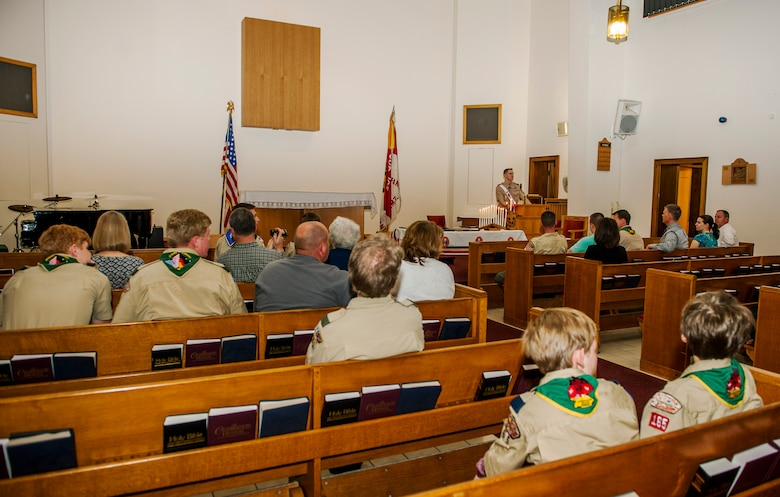 Spangdahlem community members participate in a recognition ceremony in the base chapel at Spangdahlem Air Base, Germany, May 18, 2016. The family and friends of Daniel and Matthew O'Connor, both Boy Scouts of America Troop 165 Eagle Scouts, attended the ceremony in which the scouts received their ranks. (U.S. Air Force photo by Airman 1st Class Timothy Kim/Released)