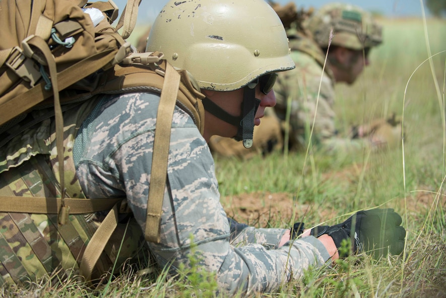 U.S. Air Force Senior Airmen Alexander Reese (left) and Kyle Macey, 39th Civil Engineer Squadron explosive ordnance disposal journeymen, take cover during a training exercise May 17, 2016, at Incirlik Air Base, Turkey. EOD Airmen trained to sharpen their skills for contingency operations overseas. (U.S. Air Force photo by Senior Airman John Nieves Camacho/Released)