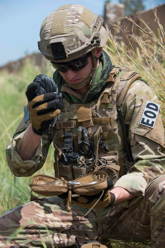 U.S. Air Force Senior Airman Alex Johnson, 39th Civil Engineer Squadron explosive ordnance disposal journeyman, readies a rope for use during a training exercise May 17, 2016, at Incirlik Air Base, Turkey. EOD Airmen divided into multiple teams to complete training objectives throughout the day. (U.S. Air Force photo by Senior Airman John Nieves Camacho/Released)