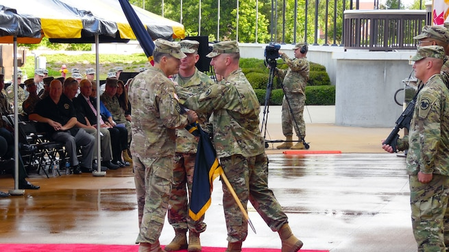 Lt. Gen. Jeffrey W. Talley, Chief of Army Reserve and Commanding General of  U.S. Army Reserve Command, is presented with the USARC flag by Command Sgt. Maj. Jim Wills, USARC Command Sgt. Maj., during the U.S. Army Reserve Command Relinquishment of Command Ceremony held at Marshall Hall, Fort Bragg, N.C., June 1, 2016. The ceremony recognized and honored the contribution the Talley family has given to the U.S. Army Reserve as Lt. Gen. Talley relinquishes his command with the exchange of the command flag. (U.S. Army Reserve photo by Lt. Col. Kristian Sorensen)
