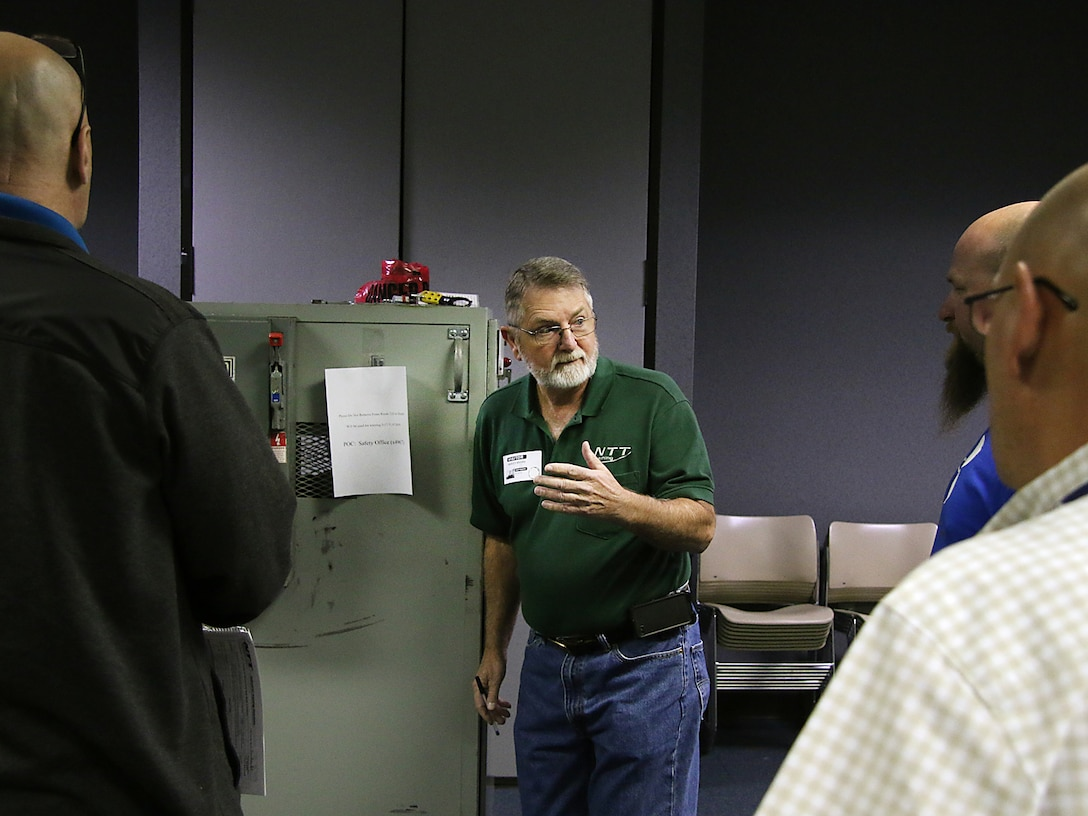 """Mr. Harvey """"Wayne"""" Rivers, Instructor with National Technology Transfer, speaks with students about the proper way to lockout/tagout electrical equipment when performing maintenance. The Tulsa District, U.S. Army Corps of Engineers held arc flash electrical training classes for their maintenance staff May 17-19, 2016, specifially targeted at instructing National Fire Protection Association 70E curriculum. (Photo by Preston Chasteen/Released)"""