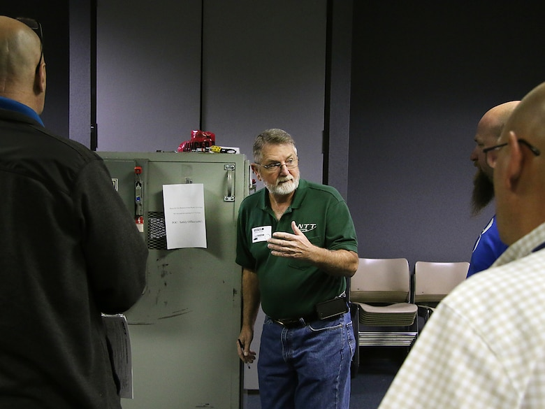"Mr. Harvey ""Wayne"" Rivers, Instructor with National Technology Transfer, speaks with students about the proper way to lockout/tagout electrical equipment when performing maintenance. The Tulsa District, U.S. Army Corps of Engineers held arc flash electrical training classes for their maintenance staff May 17-19, 2016, specifially targeted at instructing National Fire Protection Association 70E curriculum. (Photo by Preston Chasteen/Released)"