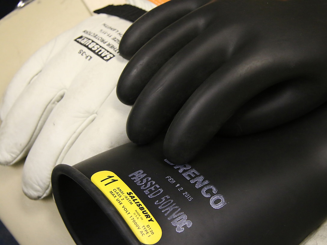 Gloves used during arc flash training are just one part of the overall personal protective equipment ensemble that is essential when performing any electrical work. The Tulsa District, U.S. Army Corps of Engineers held arc flash electrical training classes for their maintenance staff May 17-19, 2016, specifially targeted at instructing National Fire Protection Association 70E curriculum. (Photo by Preston Chasteen/Released)
