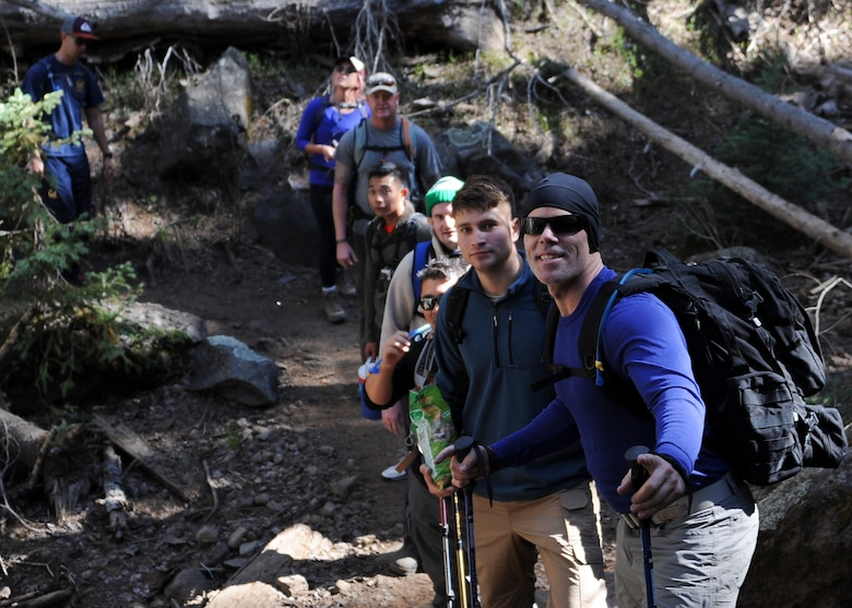 Participants of the U.S. Air Force 50 Summits Challenge hike up a mountain trail to Humphreys Peak Ariz., May 29, 2016. The level of hiking experience varied among the participants, with times ranging from eight to eleven hours to champion the 12,633 foot peak. (U.S. Air Force photo by Airman 1st Class Ashley N. Steffen/Released)