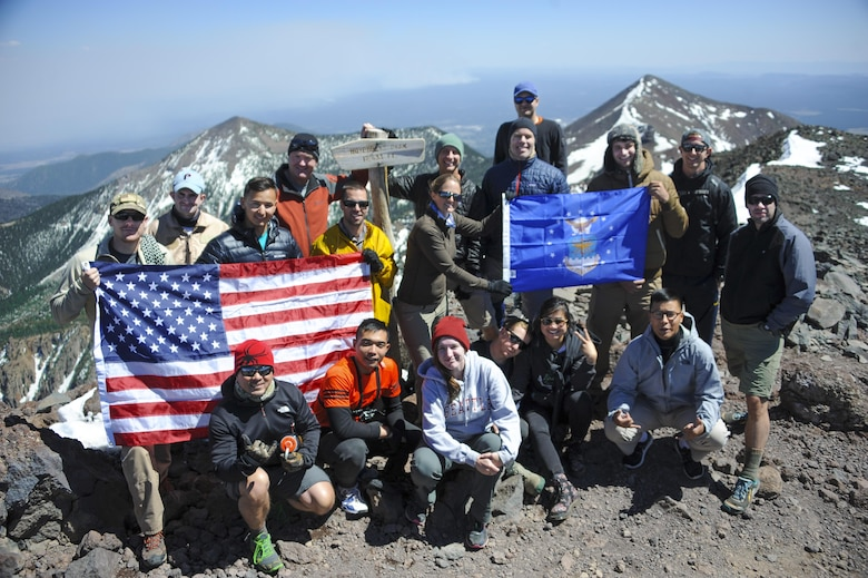 U.S. Airmen, veterans and civilians pose for a picture at the top of Humphreys Peak, Ariz., May 29, 2016. The group climbed the mountain as part of the U.S. Air Force 50 Summits Challenge, which focuses on bringing Airmen in each of the 50 states to the highest points of their respective states. (U.S. Air Force photo by Airman 1st Class Ashley N. Steffen/Released)